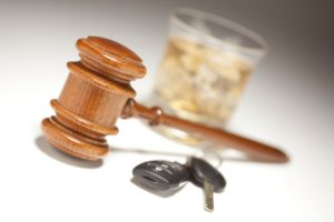 Gavel, drink, and car keys
