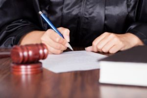 Judge signing protective order