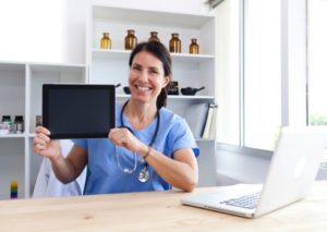 Nurse holding an ipad