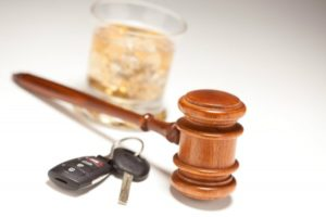 Gavel with Keys and Alcohol